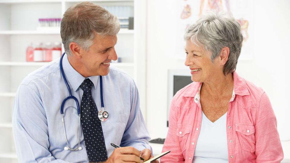 Doctor writing patient prescription